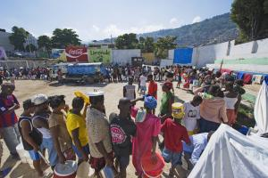 Sceptics wonder whether aid is helping at all: Haitians lining up for drinking water after the earth quake in 2010.