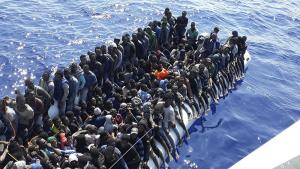 Overcrowded refugee boat on the Mediterranean Sea near the coast of Libya.