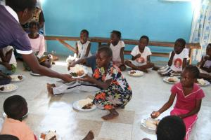 Development policy must do more to protect children: needy children receive a warm meal in Zambia.