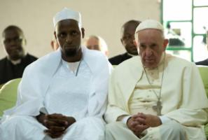 Inter-faith dialogue helps: Pope Francis visiting Bangui's Central Mosque in November. To his right: Tidiani Moussa Naibi, the mosque's imam.
