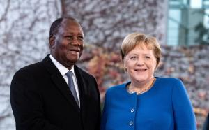 German Chancellor Angela Merkel welcoming President Alassane Ouattara to the Compact with Africa conference in Berlin in 2019.