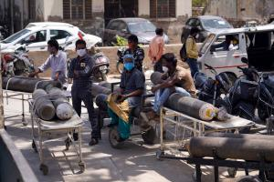 Lining up to refill oxygen cylinders in Amritsar in mid-May.