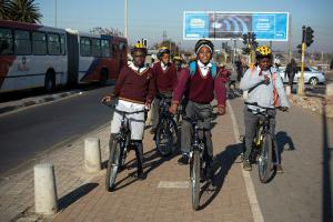 School children use a new cycle path in Soweto, Johannesburg.