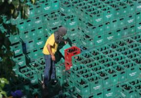 A worker with beer crates in Manila.