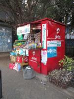 Informal shop in Nairobi with advertising for phone companies and mobile money.