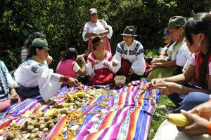 Indigenous community in Ecuador sharing a meal.