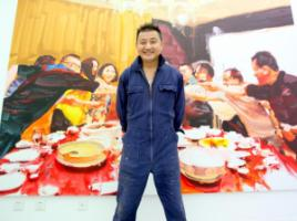 "Wang Cheng Yun in front of a work from his series ""The great consumption""."