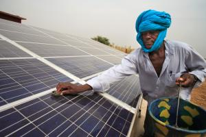 Cleaning a solar panel in Mali.
