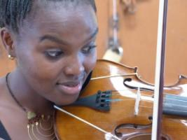 Young violinist from Korogocho.