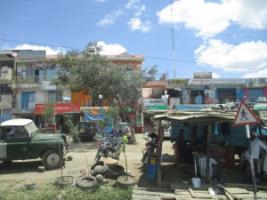 Growth in itself will not solve urban infrastructure problems: small shops on the outskirts of Nairobi.