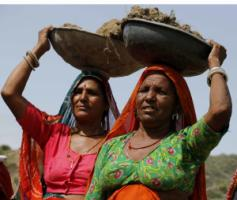 India's Mahatma Gandhi National Rural Employment Guarantee targets low-income households in rural areas: women working at minimum wage in Rajasthan.