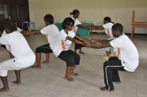 Finding balance together: YWCA-DRC leader Bibiche Kankolongo (centre) takes part in exercises herself.