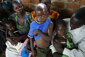 Refugee children in Uganda are waiting to be tested for malaria.