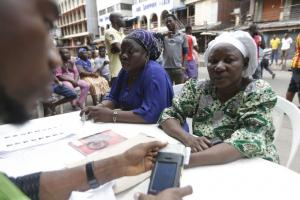 Voter registration with digital card readers in Lagos before the 2015 elections.