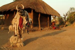 Masked dancers make contact with the spirit world: a Nayu dancer in Malawi.