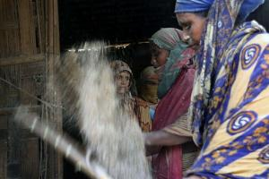 Workers at a rice mill in Bangladesh: breathing in the dust often causes lung disease.