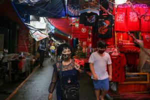 Shoppers in Jakarta's Chinatown in February: Covid-19 has slowed down business.