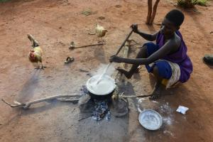 Many people all over the world, like this Tanzanian woman, still use open fires for cooking.