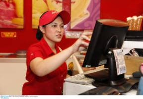 You don't need a university degree to work in a fast-food restaurant: young employee in Manila.