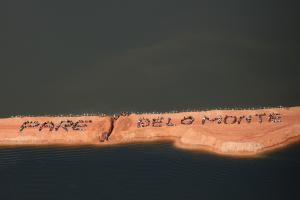 """""""Pare Belo Monte""""– """"Stop Belo Monte (dam project)"""": members  of an indigenous community demonstrating against a major infrastructure project."""