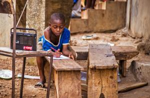 Ebola had a devastating impact on schools: attending a radio-transmitted lesson in February 2015.