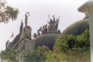 Hindu fanatics climbed Babri Mosque before tearing it down in Ayodhya in December 1992.