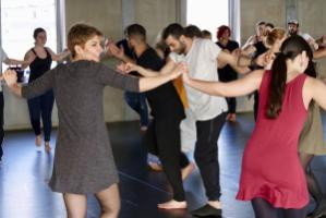 Learning to understand other cultures: Syrian migrants teach the Arab dance Dabke to Germans.