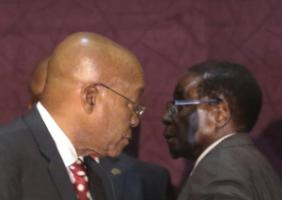 Mutually supportive: The presidents of South >frica and Zimbabwe, Jacob Zuma and Robert Mugabe.