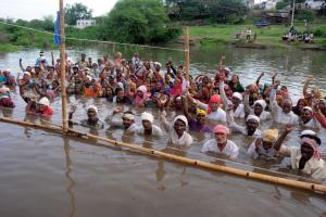 Rural people protesting against their village being submerged because of Omkreswahr dam on the Narmada river in 2012.
