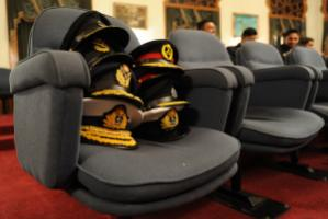 The appetite for dabbling in domestic politics has gone down: officers' hats taken off for a ceremonial dinner in Dhaka.