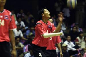 Man Veasna, a Cambodian player, warms up at the 2007 Standing Volleyball World Cup in Cambodia.