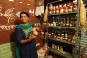 Anitha Reddy of the NGO Sahaja Samrudha shows the seed bank.