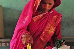 A woman casting her vote in panchayat elections in Assam on 6 February.