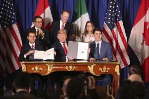 Not much is new, apart from the name: Enrique Peña Nieto, Donald Trump and Justin Trudeau celebrate the signing of the United States-Mexico-Canada agreement in November 2018.