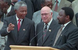 Celebrating the new constitution in May 1996: Nelson Mandela (then president), Frederik Willem de Klerk (deputy president) and Cyril Ramaphosa (chairman of the Constitutional Assembly).