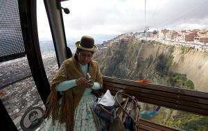 An indigenous woman rides the aerial tramway that connects the Bolivian capital La Paz with neighbouring city El Alto, 400 metres higher.