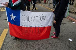 "Two protesters hold a Chilean flag with the slogan ""free education"" (in Spanish) in Santiago in June 2016."