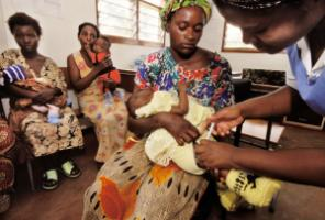 Zambian health worker immunising a child with the DPT3 vaccine.
