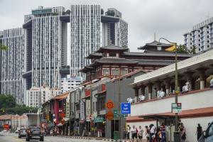 View of Singapore's Chinatown: in the background is a portion of the Pinnacle@Duxton housing complex, which was built by the state-run Housing Development Board.