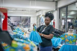 Garment worker in a DEG-supported production facility in Nigeria.