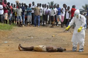 Disinfecting a person in Liberia for training purposes.