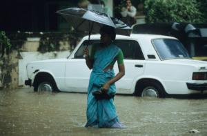 Climate change affects ICSO visions, yet many organisations' activities do not systematically take this issue into account. In many countries, monsoon rains are becoming increasingly unpredictable: woman in Bombay.