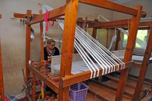 In Manshiet Nasr, Egypt, an NGO that employs women produces patchwork plaids and other textiles from old clothes.
