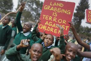 Land grabbing is a problem in many African countries. Protest by Kenyan schoolchildren in 2015.