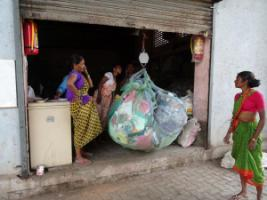Local waste pickers collect plastic waste in Mumbai, which will then be recycled.