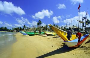 Local communities should suffer no disadvantages because of tourism: fishing boats in Sri Lanka.