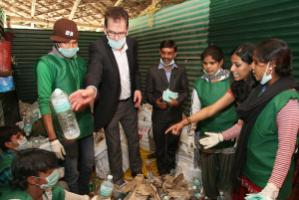 Achieving sustainability will depend in large part on changing consumer habits: Gerd Müller, Germany's development minister, visiting a project for waste collectors and recyclers in New Delhi in early 2014.