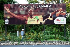 Jamaican advertising billboard with Usain Bolt.