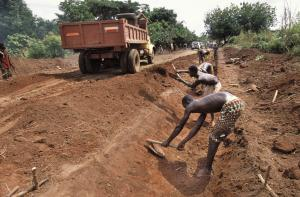 """Where mayor and council are up to their jobs, the rural transport infrastructure tends to be in  a rather good shape"": building a feeder road to connect  a village in 2006."