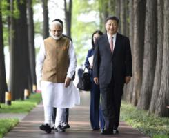 India's Prime Minister Narendra Modi with China's President Xi Jinping in Wuhan last year